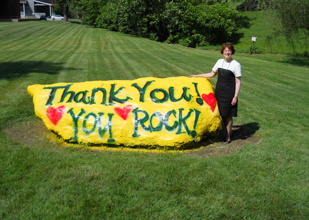 President Gray at the Rock, Hollins' shale billboard, first painted by the class of 1982.