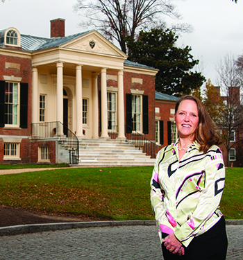 Catherine Rogers Arthur '90 in front of the Homewood House Museum, where she serves as director and curator. The museum is located on the Johns Hopkins University campus in Baltimore.