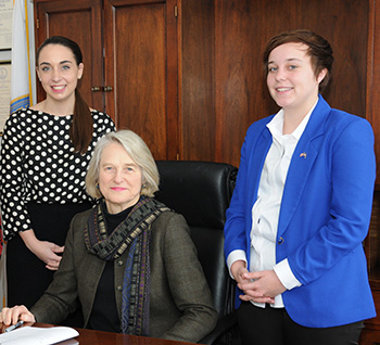 Betsy Carr '68 with Mercury Hipp '15, who was serving as an intern in January 2014. To the left of Carr is former intern Kelsey DeForest '13, who worked in Carr's office after graduation.