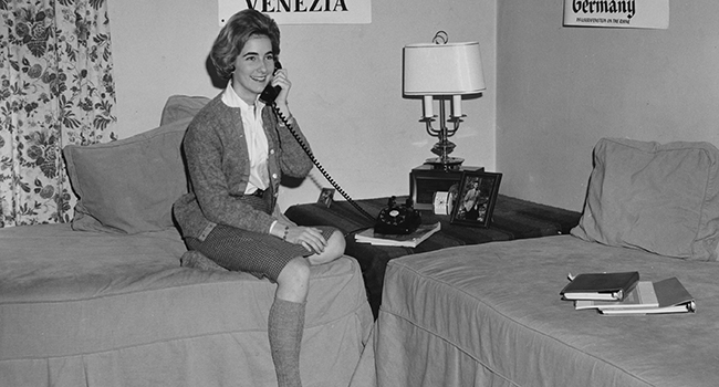 Student on her phone, 60s