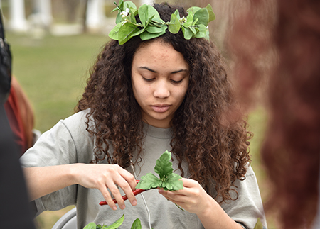 Photo of student making flower crowns