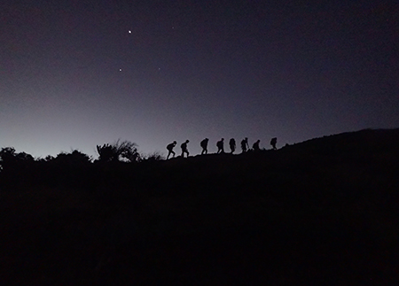 Photo of student hiking in pre-dawn in the Caribbean
