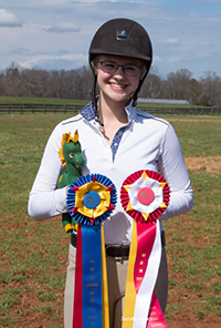 Caitlin Sheffer with riding medals