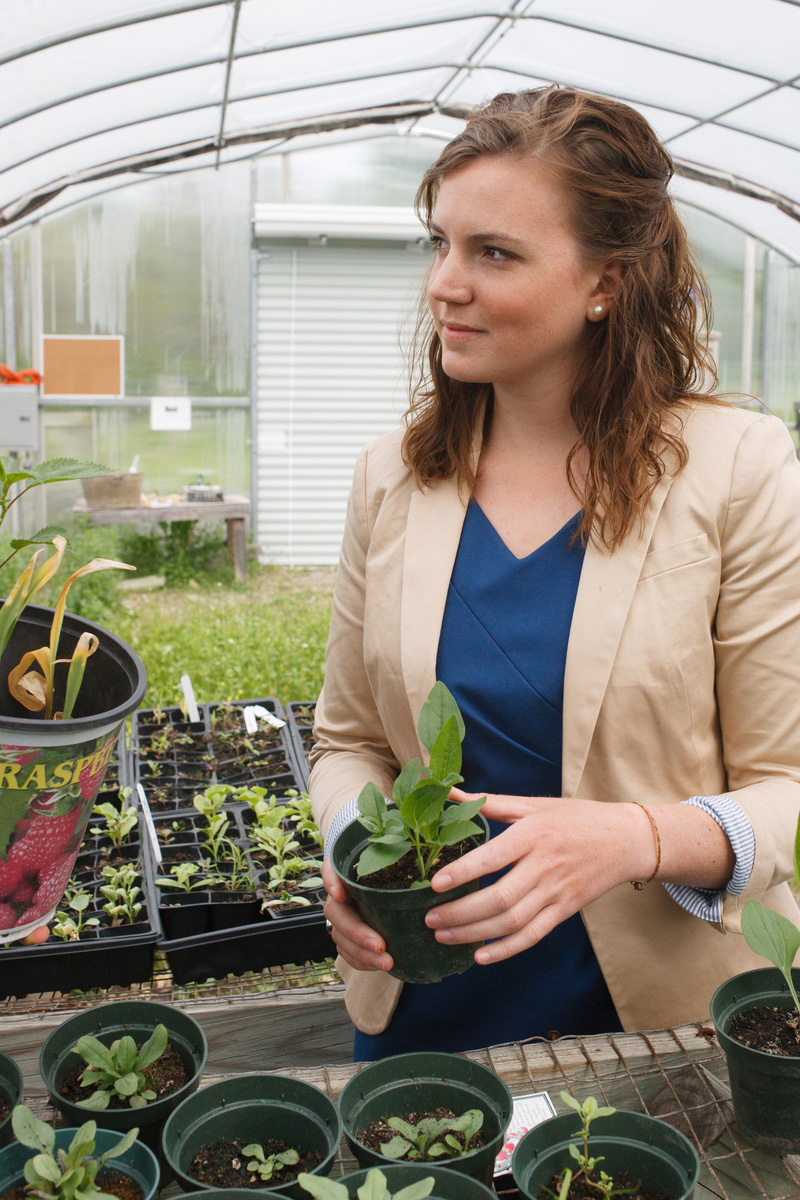 Student in greenhouse