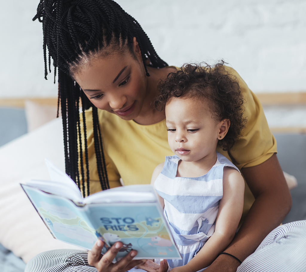 Mom and baby with book