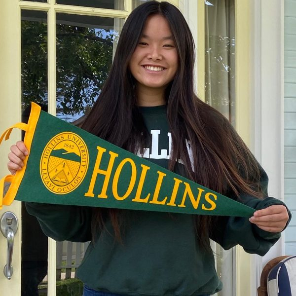 Student holding Hollins pennant