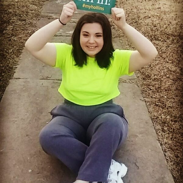 Accepted student holding postcard